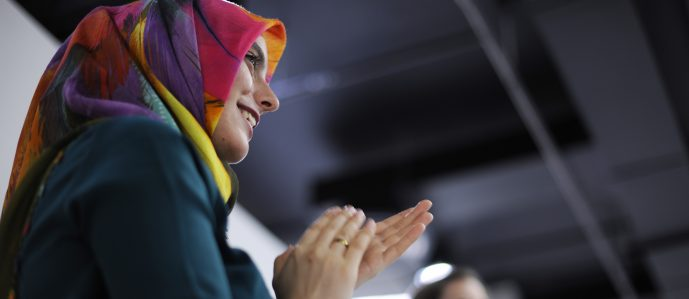 Arab business women clapping