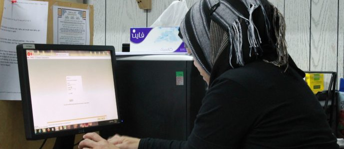 Arab woman sitting at computer
