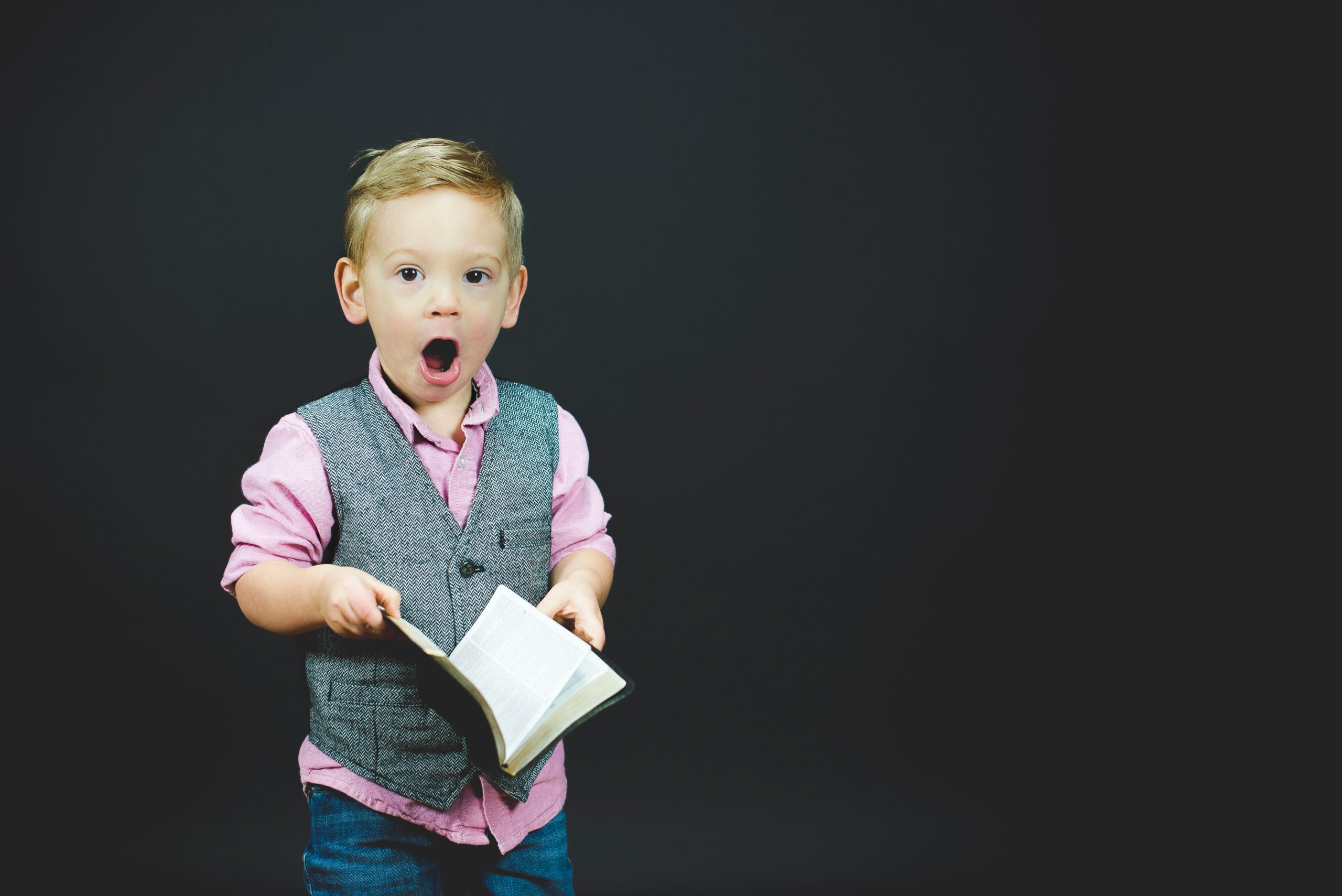 A boy holding a book